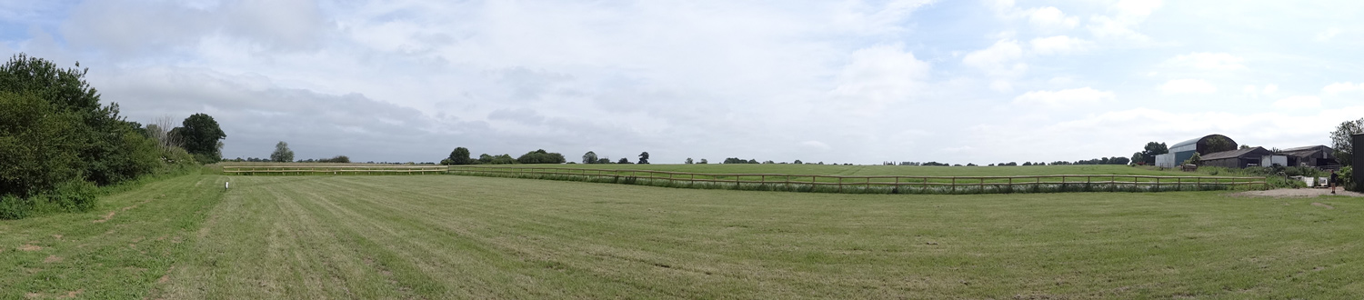 Panoramic view across the field with our 5 Caravan Pitches in Essex